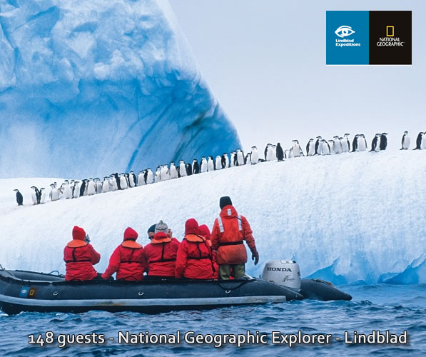 Lindblad National Geographic in Antarctica with expedition guide viewing penguins